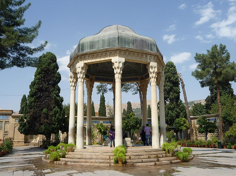 The Tomb of Hafez and its associated memorial hall, the Hafezieh, are two memorial structures erected in the northern edge of Shiraz, Iran, in memory of the celebrated Persian poet Hafez. The open pavilion structures are situated in the Musalla Gardens on the north bank of a seasonal river and house the marble tomb of Hafez. The present buildings, built in 1935 and designed by the French architect and archaeologist André Godard, are at the site of previous structures, the most well-known of which was built in 1773. The tomb, its gardens, and the surrounding memorials to other great figures are a focus of tourism in Shiraz.