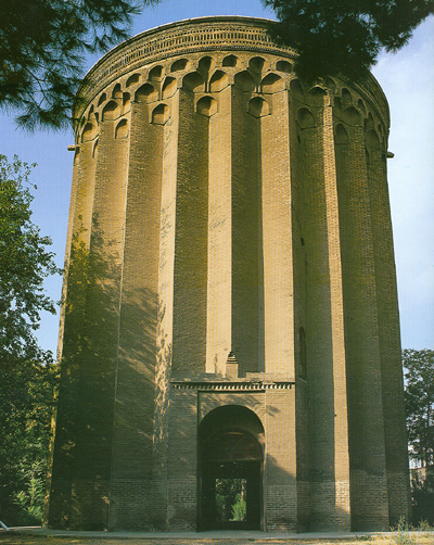 Tuqrul Tower is a 12th-century monument, located in the city of Rey, Iran. Tuqrul Tower is near Rashkan castle.    The 20 meters tall brick tower is the tomb of Seljuk ruler Tuqrul Beg, who died in Rey in 1063. Originally, like other monuments of its time, it was capped by a conical dome , which would have added to its height. The dome collapsed during an earthquake.    The thickness of the walls varies from 1.75 to 2.75 meters. The inner and outer diameters are 11 and 16 meters, respectively. The exterior shape is that of a polygon with 24 angles in its design, which is thought to contribute to the structure's stability against tremors. At the top of the tower Kufic inscriptions were originally observable. Naser al-Din Shah ordered some restorations to be made to the top part of the tower, which was collapsing in 1884. The tower is protected by Iran's Cultural Heritage Organization