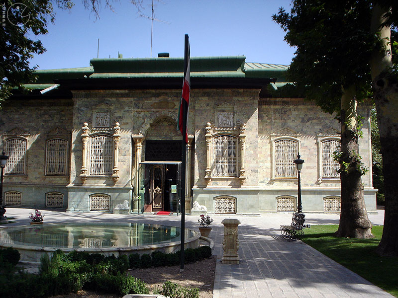 "In the north of Tehran Sa'dabad museum is called the Green House. House Shahvand green Kakhmvz·h now called, is certainly one of the most beautiful palaces in the country, which is home solar Reza Shah Pahlavi in ​​1307 and has been exploited. House Shahvand the additional building of the Ministry of War to the early reign of Reza Khan (1301 to 1307 AD) lasted, before the building was owned by a man named ""Ali"" who was then a prominent landowners and the hill House rests in his name to ""Alikhan hill"" is known. It was the first palace was built by architects and artists. Hussein Lorzadeh decorate the facade, Mirza Jafar architectural tiles, wall sculptures and seal B. Hussein Taherzadeh it has done exceptionally unique and elegant. The exterior of the palace, unique mineral green gems used Khamse Zanjan appellation is why the palace. Mortar rocks mirage caused by expansion and contraction properties, to avoid crushing the stones have been used at different temperatures. The building, the palace is set in the side of the operation reached Sa'dabad. The main palace in the northwest of the Alborz mountains opens. Prospect House from the south, the city of Tehran and is the only palace picturesque landscape unfolds before the viewer's eyes. House floor area of ​​about 1372 square meters excluding the basement."