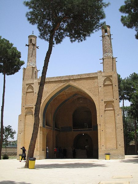 The Monar Jonban (Shaking Minarets), or Menar-e-jomban, is a monument located in Isfahan, in central Iran. Construction began in the 14th century to cover the grave of Amu Abdollah Soqla. Its notable feature is that if one of the minarets is shaken, the other minaret will shake as well. The iwan  and porch were probably erected shortly after 1316 as a shrine for Amu Abdollah Soqla, a hermit buried here. The brick minarets were constructed later, and are probably of Safavid dynasty era origin (c. 15th—17th centuries). The iwan is 10 metres (33 ft) high and 10 metres (33 ft) in width, the minarets are 7 metres (23 ft) taller and are 4 metres (13 ft) in circumference. The roof above the shrine contains some skilled brickwork. The minarets are responsible for the fame of the otherwise architecturally unremarkable shrine. Because of the ratio between the height and width of the minarets and the width of the iwan, if one minaret is shaken, the other will shake in unison. This example of coupled oscillation can be observed from ground level.