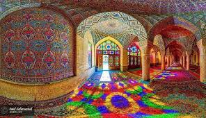 "The Nasir ol Molk Mosque, also known as the Pink Mosque, is a traditional mosque in Shiraz, Iran. It is located at the district of Gowad-e-Araban, near Sah  Cheraq Mosque. The mosque includes extensive colored glass in its facade, and displays other traditional elements such as the (""five concaved"") design. It is named in popular culture as the Pink Mosque, due to the usage of considerable pink color tiles for its interior design."