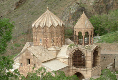 The St. Stepanos Monastery or Monastery of St. Stephen the Protomartyr (Armenian:Maghardavank  is an Armenian monastery about 15 km northwest of Jolfa city, East Azarbaijan Provin cenorthwest Iran. It is situated in a deep canyon along the Arax river on the Iranian side of the border between Nakhchivan Autonomous Republic and Iran. It was built in the 9th century and rebuilt in the Safavid era after several earthquakes damaged it.
