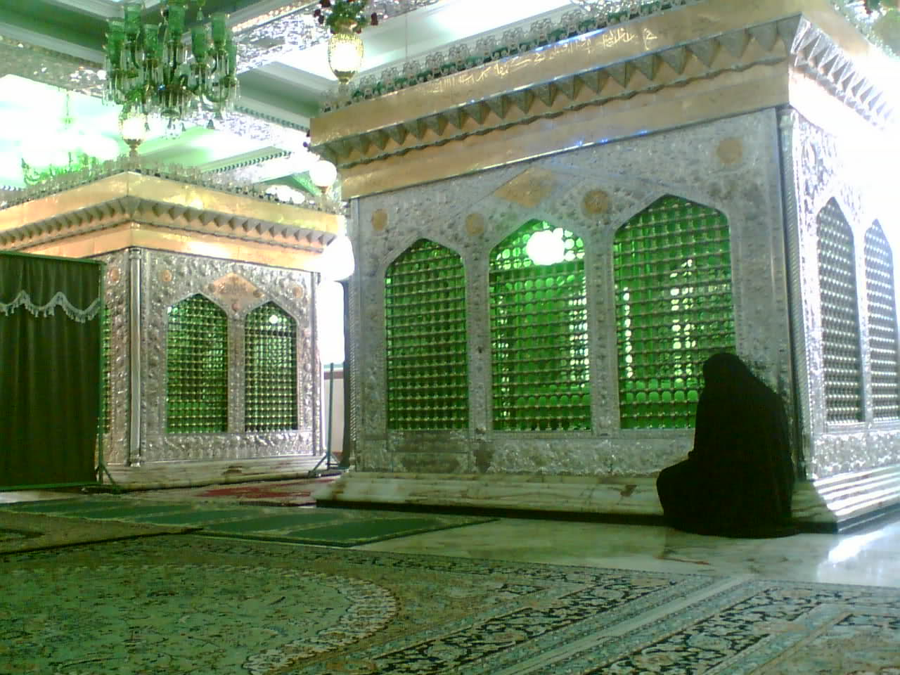 "These two Imam-born are the immediate descendant of Imam Mosa IbnJafar (the 7th Imam of Shiite Muslims). This holy shrine is located beside the road of Torghabeh, one of the most beautiful summer resorts nearMashhad.It is narrated that these two Imamzadehs were the sons of Imam Mūsá al-Kāżim and also were the brothers of Imam Reza. These two Imamzadehs came to Iran with Imam Reza and were martyred in this region. This holy religious monument is a place where people from all over theKhorasan province and Iran come here to pray. They believe that their vows will be granted in this place. The front faces of the walls are made from bricks and tiles and two gates open toward inside. One of these gates directly opens toward a hall where two tombs are located and another gate opens toward ""shoes room"" and this room is connected to the tombs hall. Writings on the tiles of walls show that they have been written and installed in three different periods. The oldest writing is a Nastaliqcalligraphy which the date of 1957 is mentioned in the text and in the end of the text the date of 1958 is registered. The majority of the pilgrims who visit this shrine are from Arabic nationalities near the Persian Gulf."